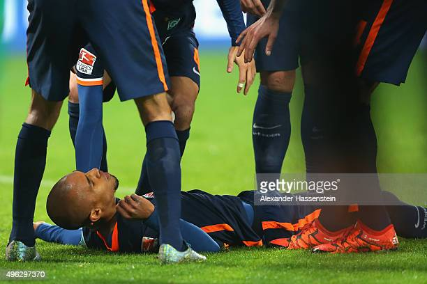Theodor Gebre Selassi of Bremen on the field after getting injured during the Bundesliga match between FC Augsburg and SV Werder Bremen at WWK Arena...