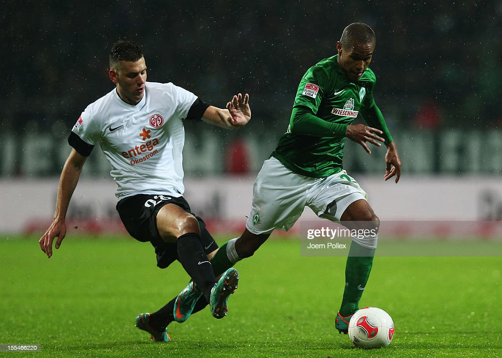 Theodor Gebre Selassie of Bremen and Adam Szalai of Mainz compete for the ball during the Bundesliga match between SV Werder Bremen and 1. FSV Mainz 05 at Weser Stadium on November 4, 2012 in Bremen, Germany.