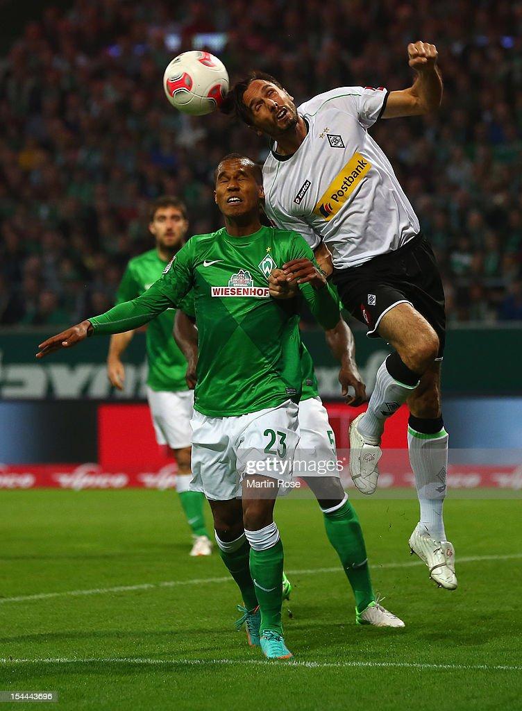 Theodor Gebre Selassie of Bremen and Martin Stranzl of Gladbach head for the ball during the Bundesliga match between Werder Bremen and Borussia...