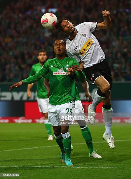 Theodor Gebre Selassie of Bremen and Martin Stranzl of Gladbach head for the ball during the Bundesliga match between Werder Bremen and Borussia...