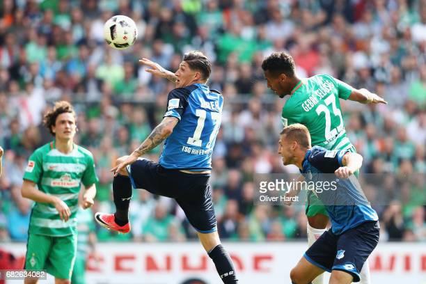 Theodor Gebre Selassie of Bremen and Steven Zuber of Hoffenheim compete for the ball during the Bundesliga match between Werder Bremen and TSG 1899...