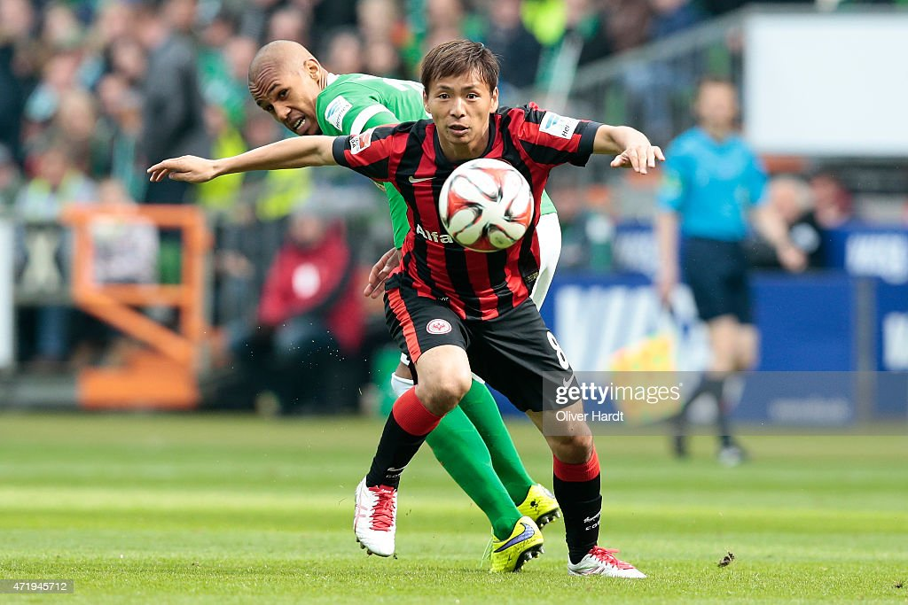 Theodor Gebre Selassie of Bremen and Takashi Inui of Frankfurt compete for the ball during the First Bundesliga match between SV Werder Bremen and...