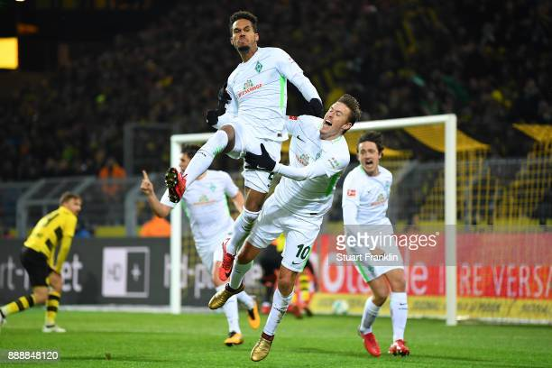 Theodor Gebre Selassie of Bremen celebrates after he scored a goal to make it 12 with Max Kruse of Bremen during the Bundesliga match between...