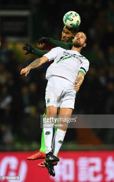 Theodor Gebre Selassie of Bremen is challenged by Martin Harnik of Hannover during the Bundesliga match between SV Werder Bremen and Hannover 96 at...