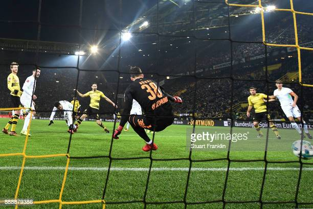 Theodor Gebre Selassie of Bremen scores a goal past goalkeeper Roman Buerki of Dortmund to make it 12 during the Bundesliga match between Borussia...