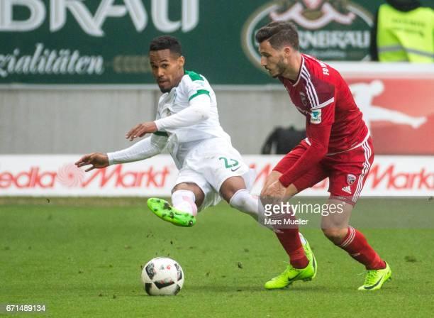Theodor Gebre Selassie of Werder Bremen is challenged by Mathew Leckie of Ingolstadt during the Bundesliga match between FC Ingolstadt 04 and Werder...