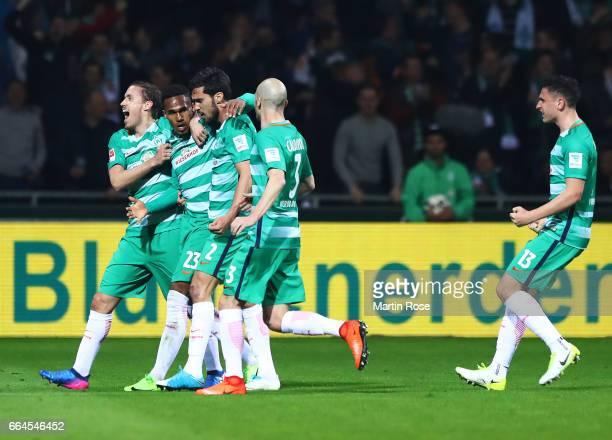 Theodor Gebre Selassie of Werder Bremen is congratulated after scoring the first goal during the Bundesliga match between Werder Bremen and FC...