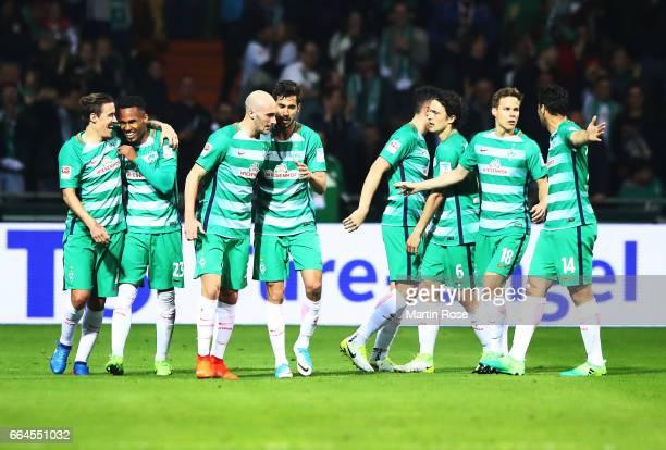 Theodor Gebre Selassie of Werder Bremen is congratulated by Max Kruse of Werder Bremen after scoring the first goal during the Bundesliga match...
