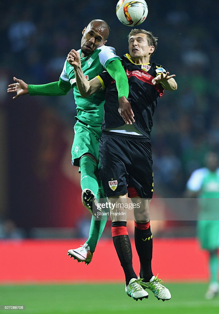 Theodor Gebre Selassie of Werder Bremen jumps with Daniel Schwaab of Stuttgart during the Bundesliga match between Werder Bremen and VfB Stuttgart at Weserstadion on May 2, 2016 in Bremen, Germany.