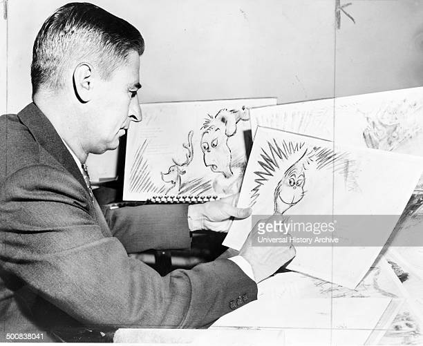 Theodor Seuss Geisel 1904 – 1991 American writer poet and cartoonist at work on a drawing of a grinch the hero of his forthcoming book 'How the...