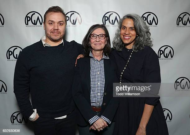 Theodore Melfi Donna Gigliotti and Mimi Valdes attend the 28th Annual Producers Guild Awards Nominees Breakfast at Saban Theatre on January 28 2017...