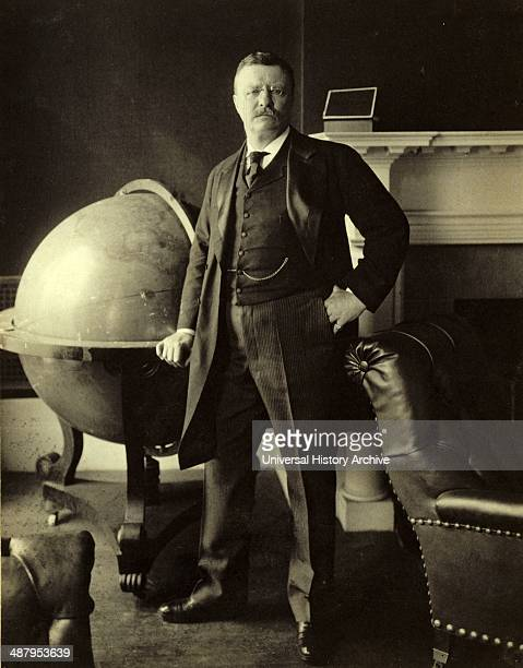 Theodore Roosevelt fulllength portrait standing beside large globe facing front 1903