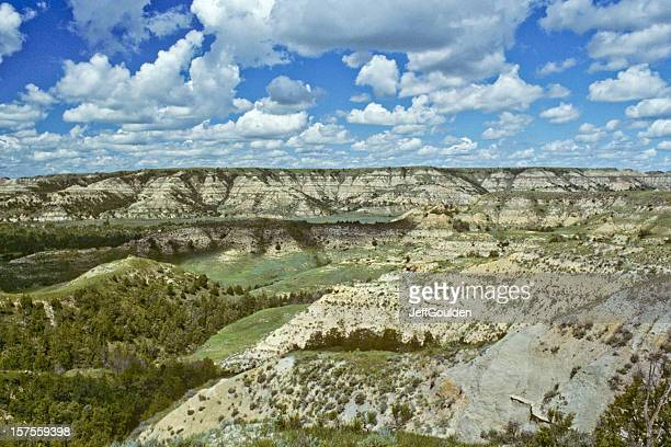 Cloud Formation Over a Badland Canyon