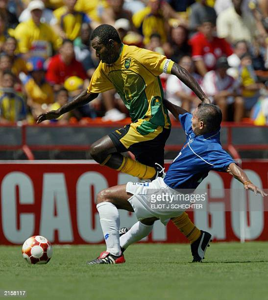 Theodore Whitmore of Jamaica tangles with John Javier Restrepo of Colombia in the first period of their 2003 CONCACAF Gold Cup match 13 July 2003 at...