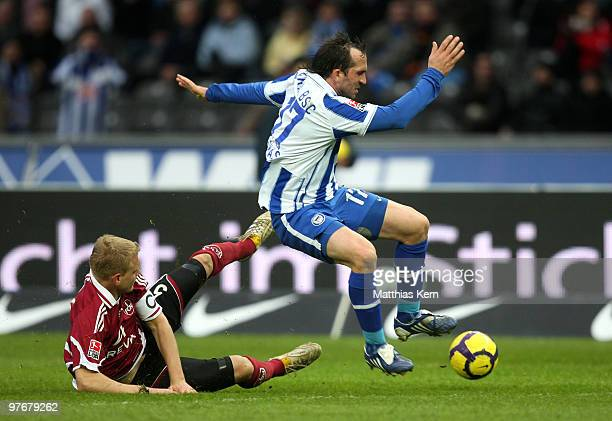 Theofanis Gekas of Berlin battles for the ball with Andreas Wolf of Nuernberg during the Bundesliga match between Hertha BSC Berlin and 1FC Nuernberg...