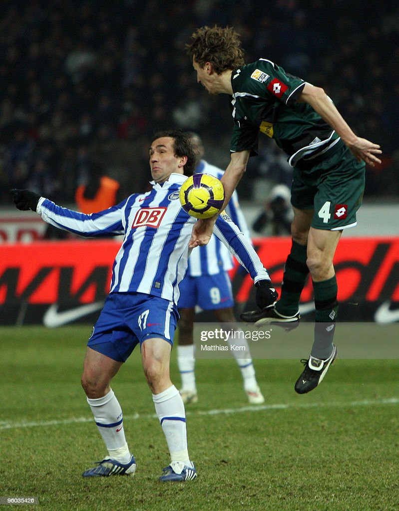 Theofanis Gekas of Berlin battles for the ball with Roel Brouwers of Moenchengladbach during the Bundesliga match between Hertha BSC Berlin and...
