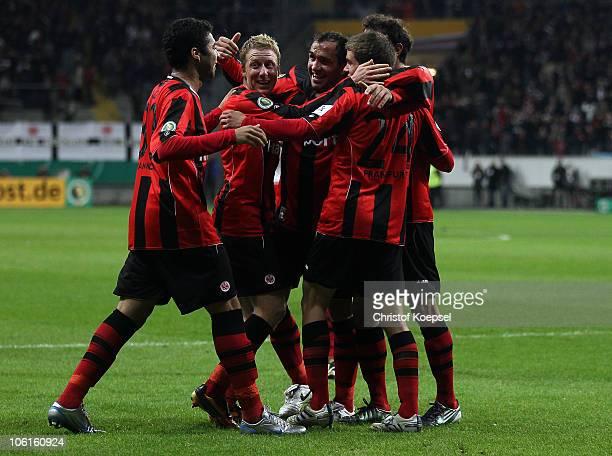 Theofanis Gekas of Frankfurt celebrates the third goal with Caio Patrick Ochs Sebastian Jung and Halil Altintop during the DFB Cup match between...