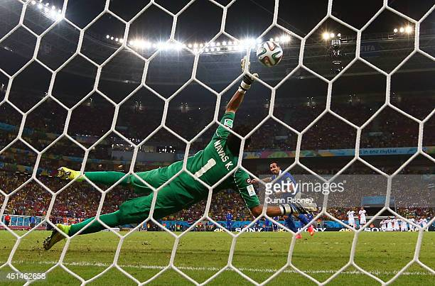 Theofanis Gekas of Greece has his penalty kick saved by Keylor Navas of Costa Rica during a shootout in the 2014 FIFA World Cup Brazil Round of 16...