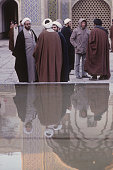 Theology students stand in the courtyard of Feyzieh seminary in Qom Iran 1st February 1986