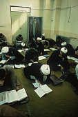 Theology students study Qoranic texts in a classroom at Feyzieh seminary in Qom Iran 1st February 1986 Qom is a major centre of Shi'ite Islam
