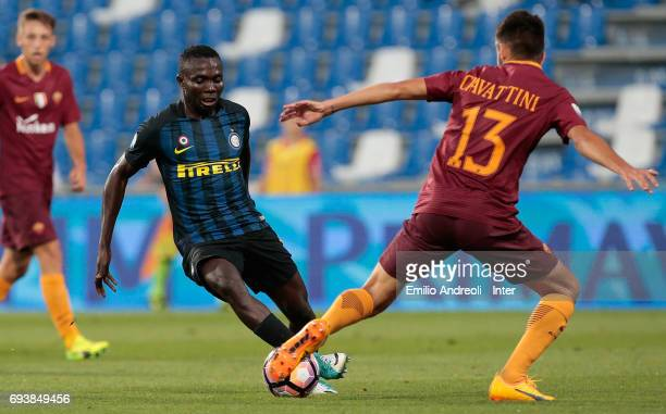 Theophilus Awua of FC Internazionale Milano competes for the ball with Stefano Ciavattini of As Roma during the Primavera TIM Playoffs match between...