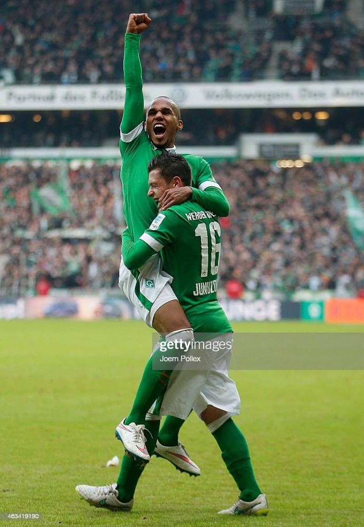 Theorod Gebre Selassie (L) of Bremen celebrates with his team mate Zlatko Junuzovic after scoring his team's third goal during the Bundesliga match between SV Werder Bremen and FC Augsburg at Weserstadion on February 14, 2015 in Bremen, Germany.