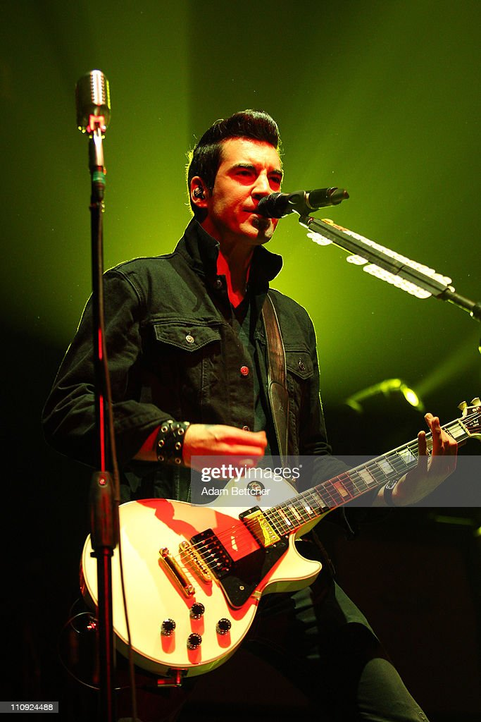 Theory of a Deadman lead singer <a gi-track='captionPersonalityLinkClicked' href=/galleries/search?phrase=Tyler+Connolly&family=editorial&specificpeople=709290 ng-click='$event.stopPropagation()'>Tyler Connolly</a> performs during the 2011 Avalanche Tour at the Roy Wilkins Auditorium on Saturday, March 26, 2011 in St. Paul, Minnesota.
