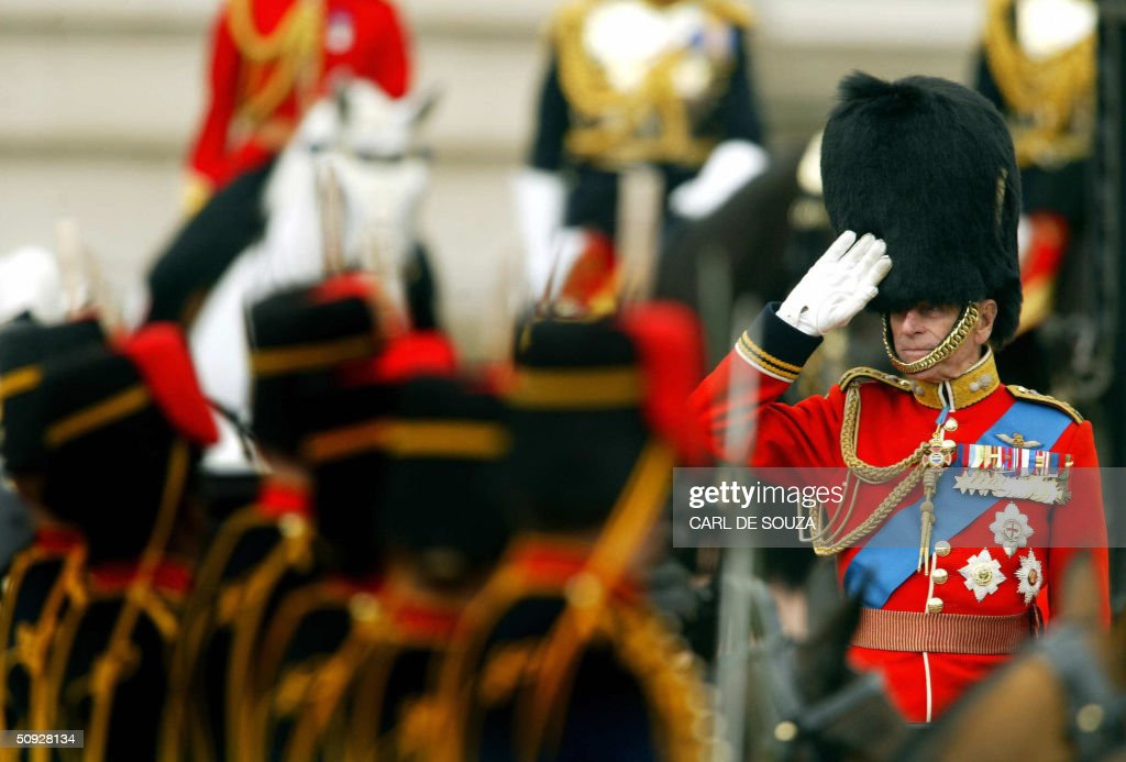 Ther Duke of Edinburgh in military uniform salutes the Kings Troop Royal Horse Artillery as they ride past Buckingham Palace in a rehearsal of Trooping the Colour 05 June 2004, in London. The ceremonial will take place 12 June.