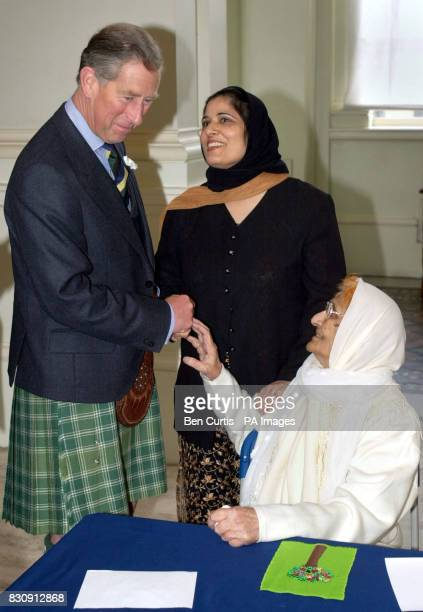 Ther Duke of Rothesay Prince Charles speaks to Azmat Bibi whom he said reminded him of his grandmother accompanied by day care officer at Glasgow...