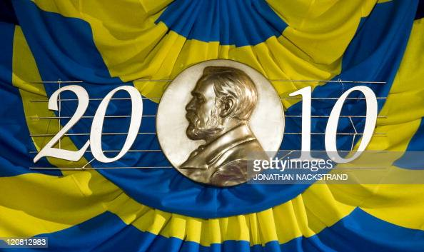 Ther Swedish flag with a representation of Swedish industrialist Alfred Nobel is displayed at the Stockholm Concert Hall on December 10 2010 in...