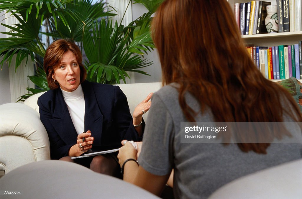 Therapist and Patient in a Counseling Session : Stock Photo