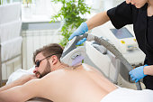 Permanent hair removal at beautician's with laser therapy