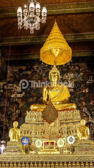 Theravada Buddhist Altar With Golden Buddha In Meditation With