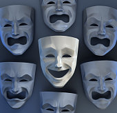 Comedian and tragedy theater masks on reflective glossy background. 3D rendered graphics.