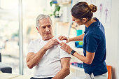 Cropped shot of an attractive young female physiotherapist working with a senior male patient