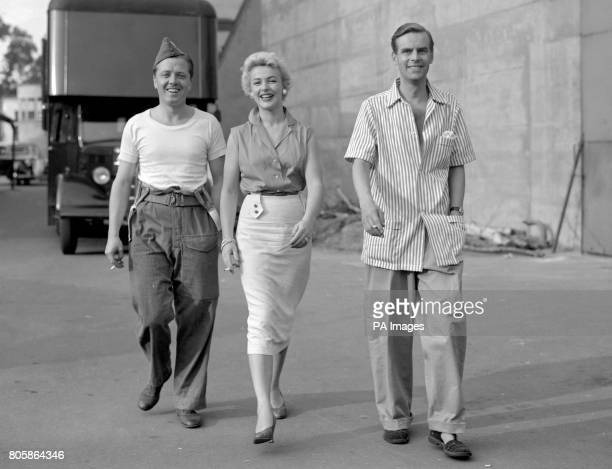 Theres time for a stroll and a smoke before they have to get on parade again Richard Attenborough Jill Adams and Ian Carmichael were relaxing between...