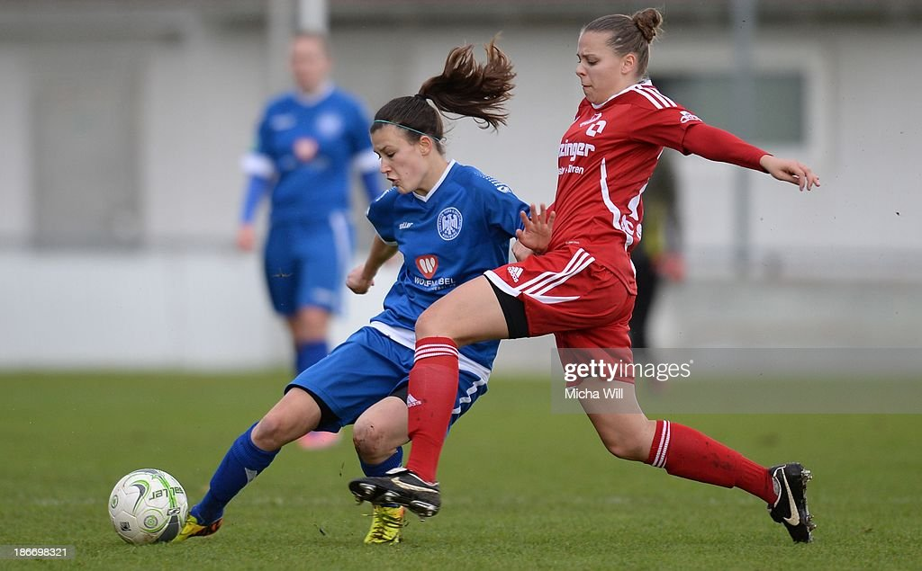 Theresa Damm (L) of Wuerzburg is challenged by Sinah Ammann of Willstaett-Sand during the Second Bundesliga match between ETSV Wuerzburg and SC Sand at Sportpark Herieden on November 3, 2013 in Wuerzburg, Germany.