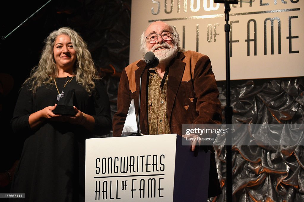 Theresa Garcia and Robert Hunter speak onstage at the Songwriters Hall Of Fame 46th Annual Induction And Awards at Marriott Marquis Hotel on June 18...