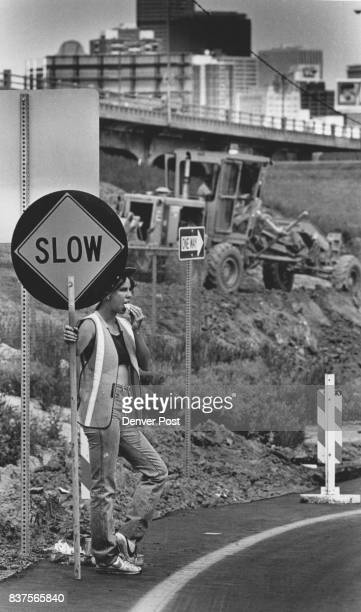 Theresa Haigler working traffic control Wednesday afternoon along the construction area for the detour of the Colfax Viaduct Credit The Denver Post