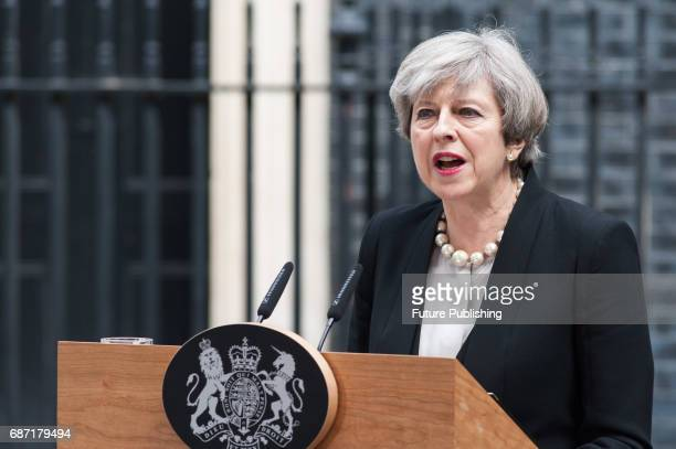 Theresa May gives a statement in front of 10 Downing Street following a terrorist attack in Manchester after chairing a meeting of Cobra the...