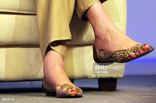 Theresa May MP and Shadow Secretary of State for Work and Pensions and Shadow Minister for Women shows off her distinctive shoes as she speaks at the...
