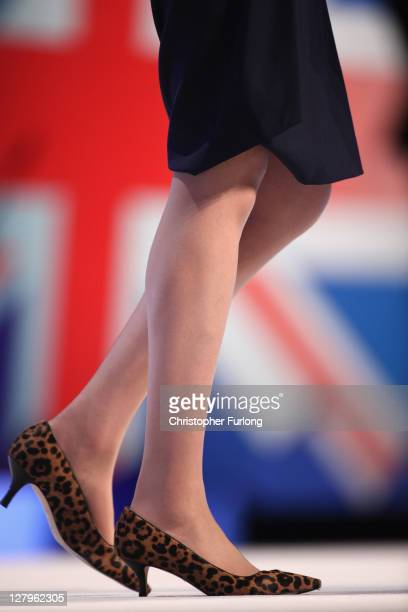 Theresa May Secretary of State for the Home Women and Equalities reknowned for her array of shoes addresses delegates during the Conservative Party...