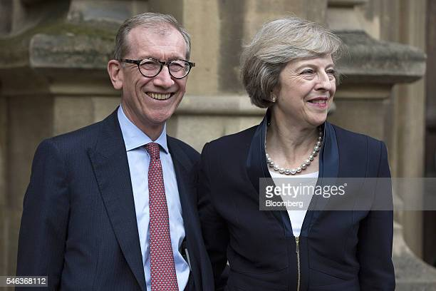 Theresa May UK home secretary right stands with her husband Philip in front of the Houses of Parliament ahead of a news conference in London UK on...