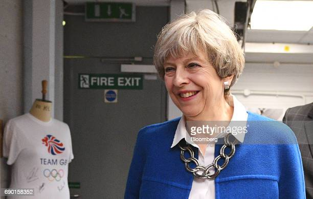 Theresa May UK prime minister and leader of the Conservative Party tours a uniform factory during a general election campaign event in Accrington...