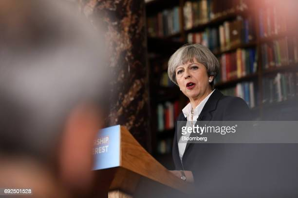 Theresa May UK prime minister and leader of the Conservative Party delivers a speech at the Royal United Services Institute in London UK on Monday...