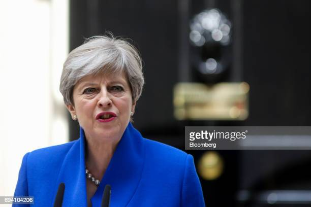 Theresa May UK prime minister and leader of the Conservative Party delivers a speech outside number 10 Downing Street in London UK on Friday June 9...