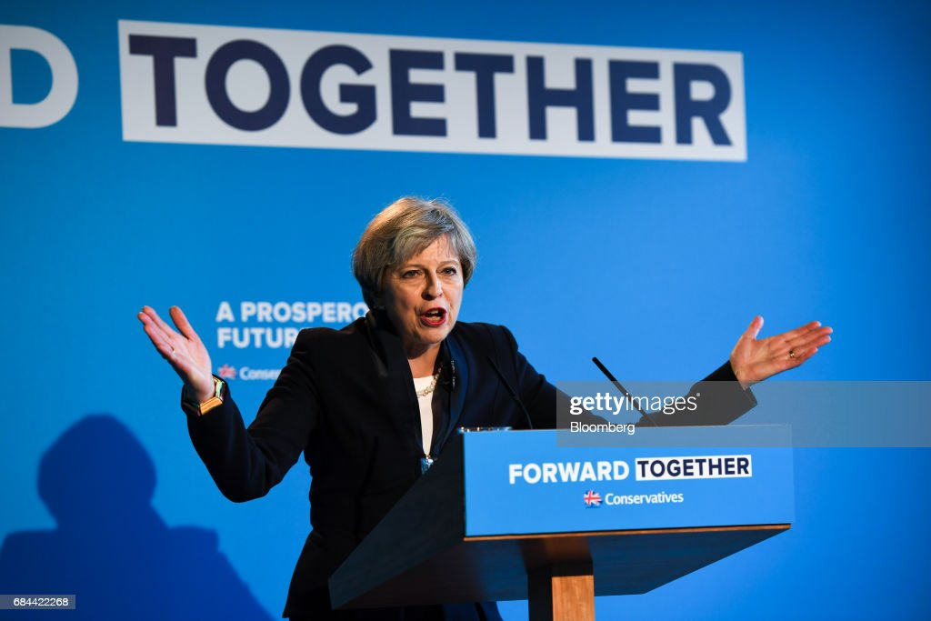 Theresa May, U.K. prime minister and leader of the Conservative Party, gestures while speaking during the launch of the party's general election manifesto at Dean Clough Mills in Halifax, U.K., on Thursday, May 18, 2017. May positioned herself as the champion of 'ordinary, working people' against 'elites' as she set out an election platform that represents a clean break with the way Britain has been governed for at least 30 years. Photographer: Chris J. Ratcliffe/Bloomberg via Getty Images