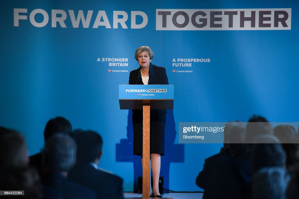 Theresa May, U.K. prime minister and leader of the Conservative Party, speaks during the launch of the party's general election manifesto at Dean Clough Mills in Halifax, U.K., on Thursday, May 18, 2017. May positioned herself as the champion of 'ordinary, working people' against 'elites' as she set out an election platform that represents a clean break with the way Britain has been governed for at least 30 years. Photographer: Chris J. Ratcliffe/Bloomberg via Getty Images