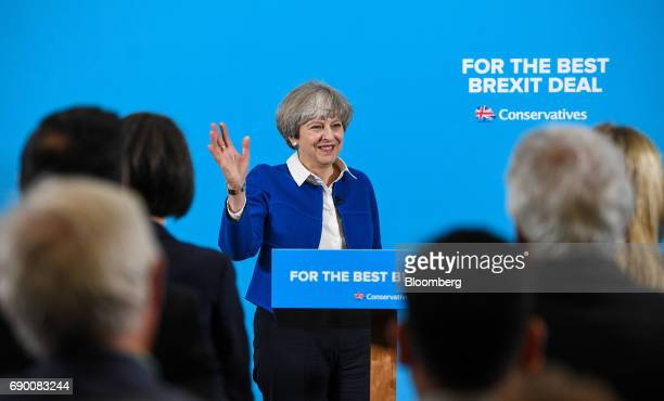 Theresa May UK prime minister and leader of the Conservative Party gestures as she speaks during a generalelection campaign event in Wolverhampton UK...