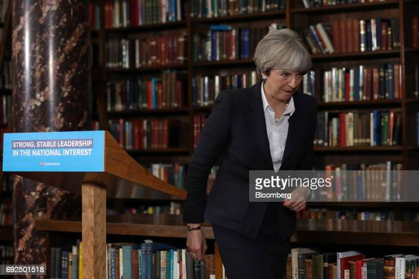 Theresa May UK prime minister and leader of the Conservative Party leaves after delivering a speech at the Royal United Services Institute in London...